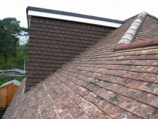 Roofing Southampton - Marley brown concrete roof tiles on dormer with plastic fascias